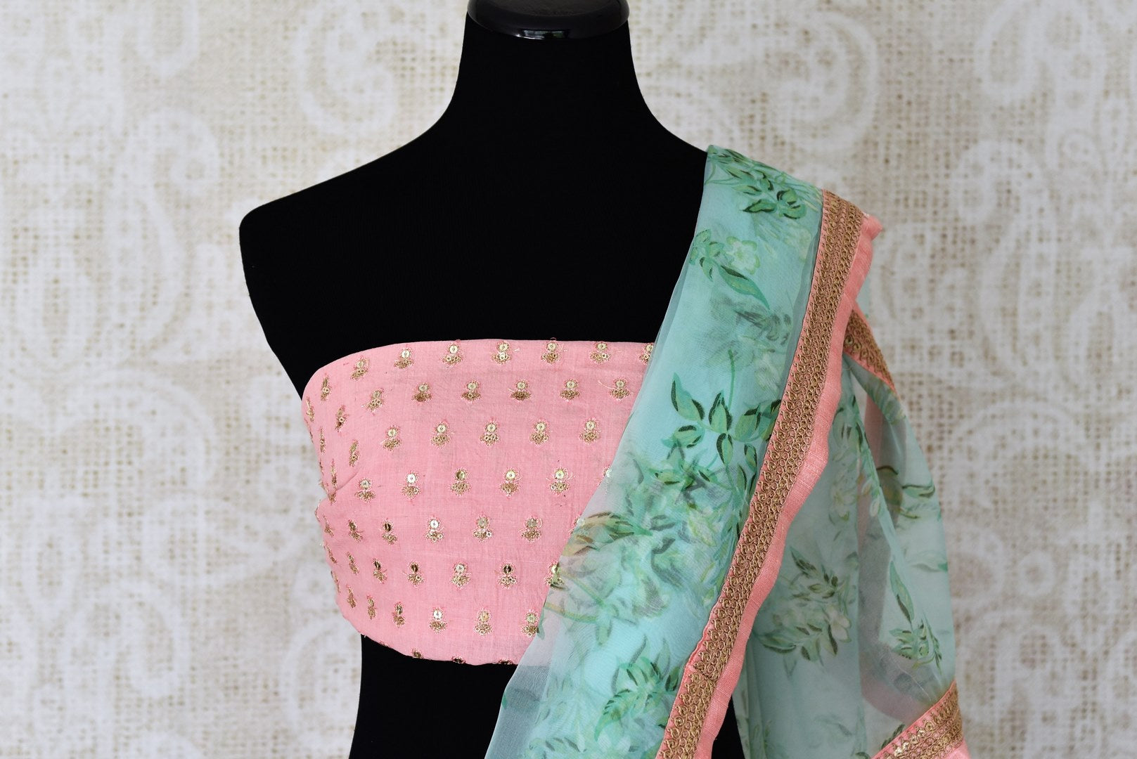 Buy beautiful blue floral print organza saree online in USA with pink embroidered border. Take your Indian style a notch up with a range of beautiful Indian clothing from Pure Elegance clothing store. We have a range of traditional Indian sarees, designer sarees, handloom saris in USA online and in our store. Shop now. -blouse pallu