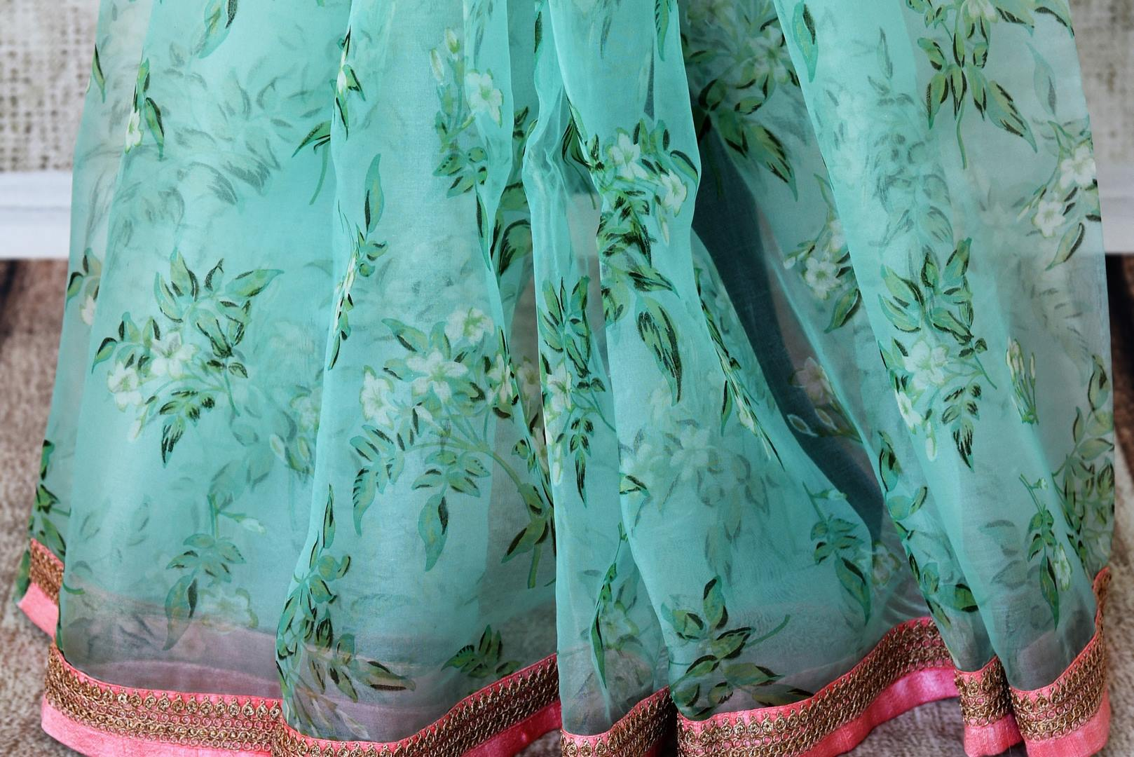 Buy beautiful blue floral print organza saree online in USA with pink embroidered border. Take your Indian style a notch up with a range of beautiful Indian clothing from Pure Elegance clothing store. We have a range of traditional Indian sarees, designer sarees, handloom saris in USA online and in our store. Shop now. -pleats