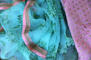 Buy beautiful blue floral print organza saree online in USA with pink embroidered border. Take your Indian style a notch up with a range of beautiful Indian clothing from Pure Elegance clothing store. We have a range of traditional Indian sarees, designer sarees, handloom saris in USA online and in our store. Shop now. -details