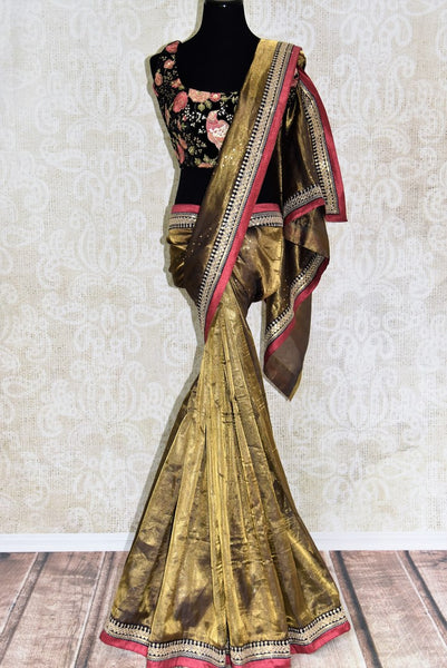 Buy shining gold tissue sari online in USA with embroidered border and saree blouse. Let your style do all the talking with a range of beautiful Indian clothing from Pure Elegance clothing store. We have a range of traditional Indian sarees, designer sarees, handloom saris in USA online and in our store. Shop now. -full view