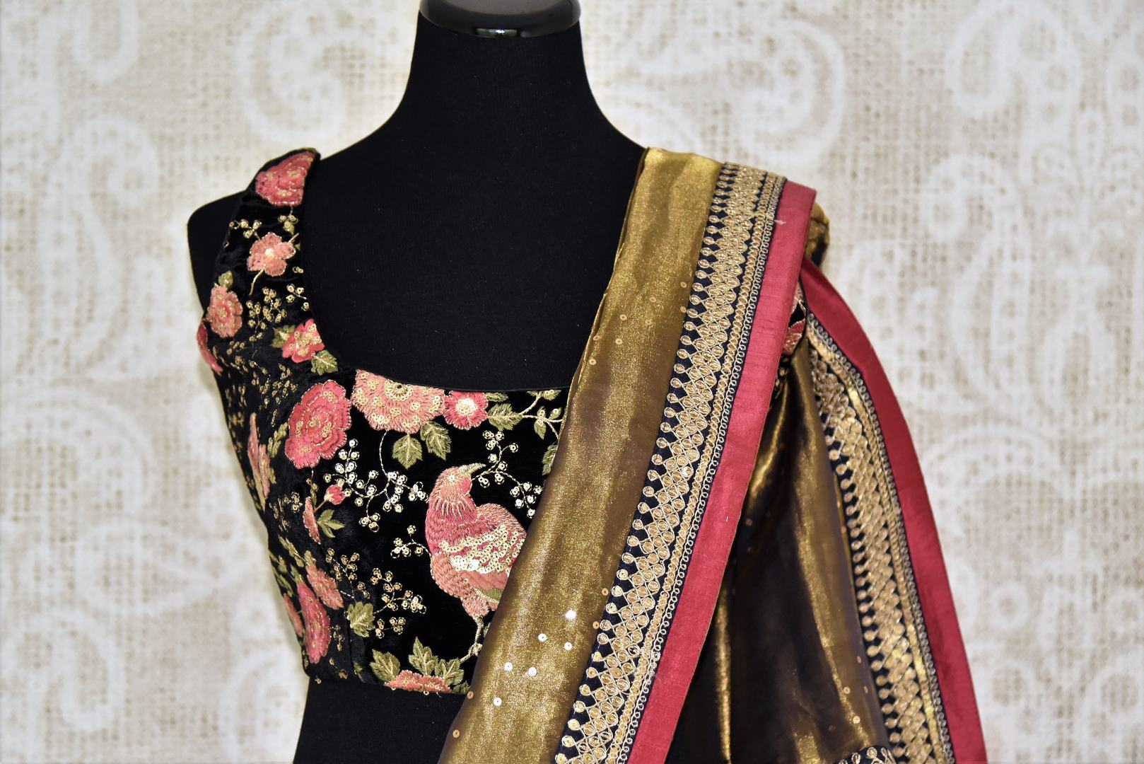 Buy shining gold tissue sari online in USA with embroidered border and saree blouse. Let your style do all the talking with a range of beautiful Indian clothing from Pure Elegance clothing store. We have a range of traditional Indian sarees, designer sarees, handloom saris in USA online and in our store. Shop now. -blouse pallu