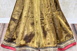 Buy shining gold tissue sari online in USA with embroidered border and saree blouse. Let your style do all the talking with a range of beautiful Indian clothing from Pure Elegance clothing store. We have a range of traditional Indian sarees, designer sarees, handloom saris in USA online and in our store. Shop now. -pleats