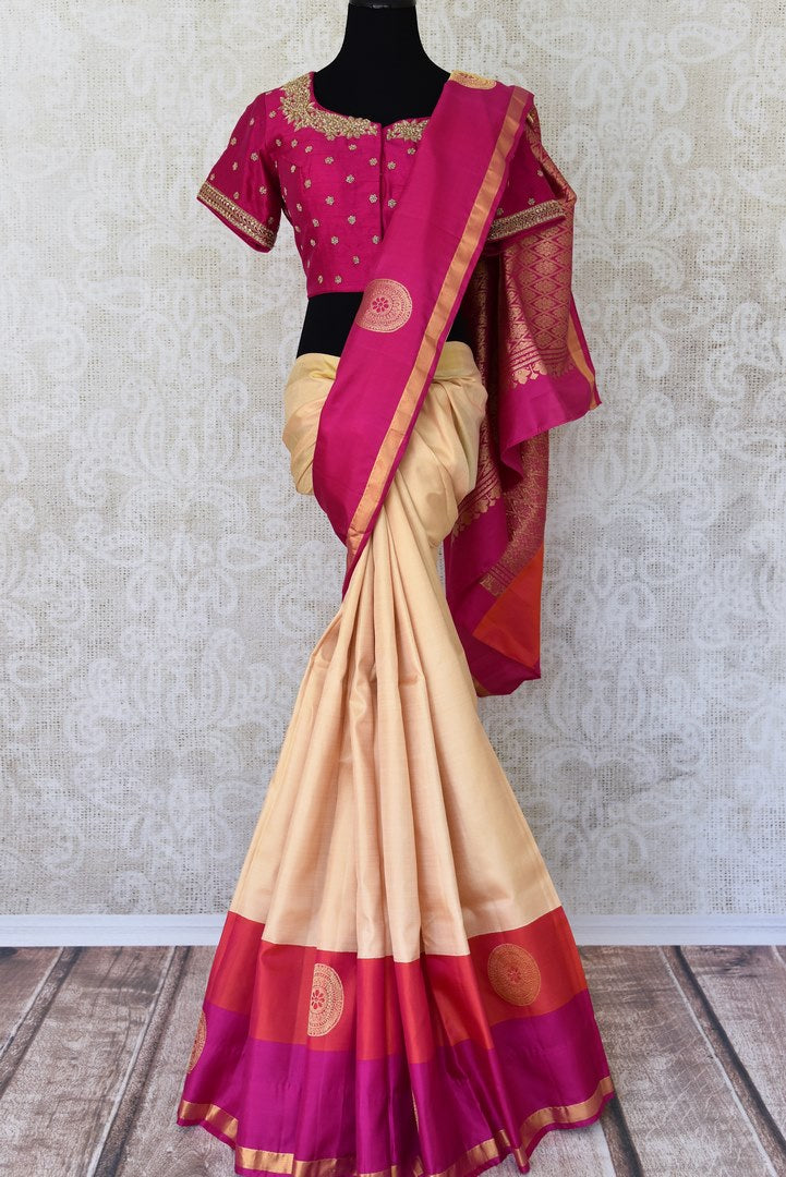 Buy off white Kanjeevaram silk saree with red and pink border online in USA and embroidered saree blouse. Let your ethnic look shine with beautiful Indian designer saris from Pure Elegance Indian fashion store in USA. You can also browse through our website and shop online.-full view