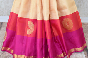 Buy off white Kanjeevaram silk saree with red and pink border online in USA and embroidered saree blouse. Let your ethnic look shine with beautiful Indian designer saris from Pure Elegance Indian fashion store in USA. You can also browse through our website and shop online.-pleats