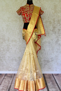 Buy cream tissue saree online in USA with red embroidered saree blouse. Let your ethnic look shine with beautiful Indian designer sarees from Pure Elegance Indian fashion store in USA. You can also browse through our website and shop online.-full view