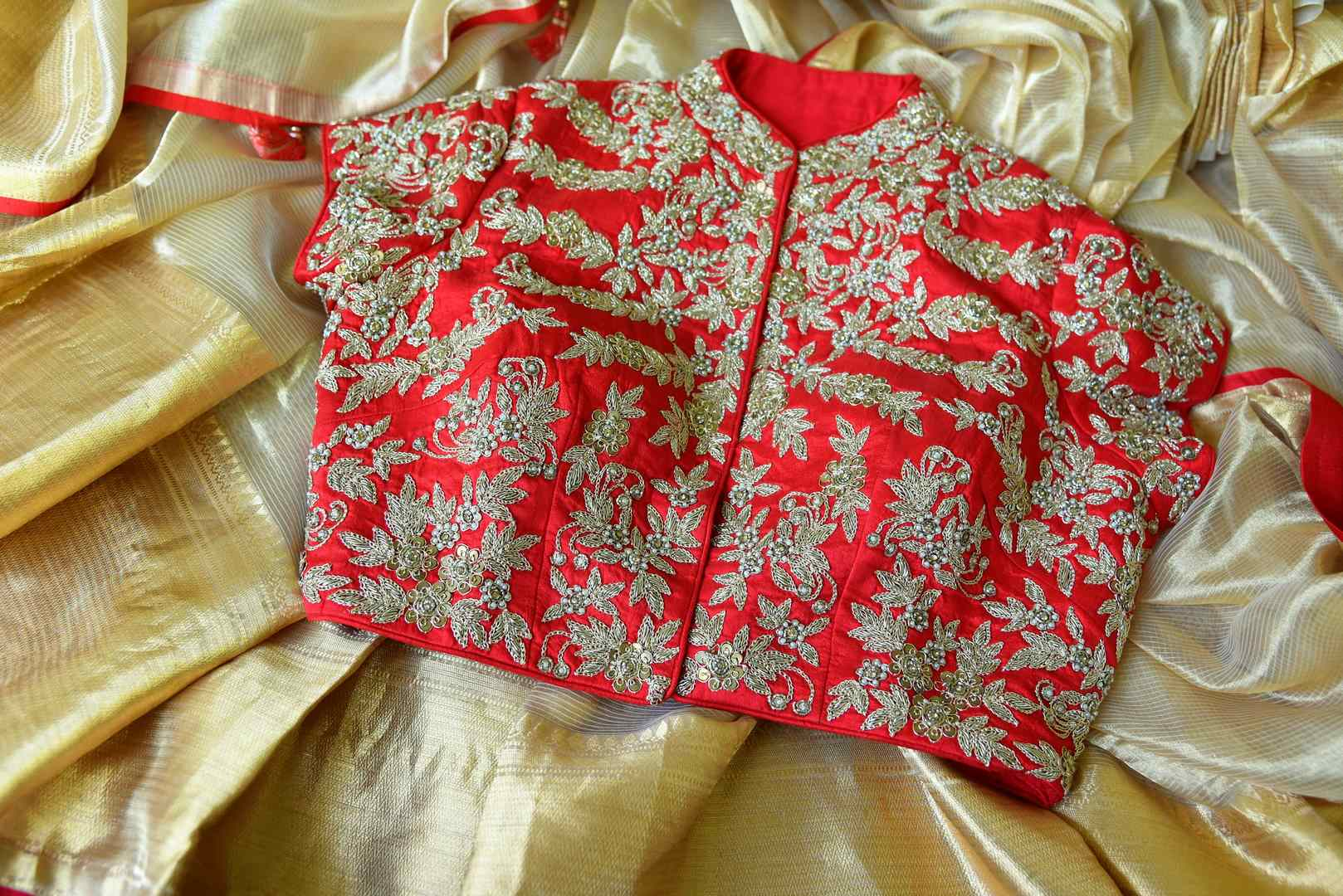 Buy cream tissue saree online in USA with red embroidered saree blouse. Let your ethnic look shine with beautiful Indian designer sarees from Pure Elegance Indian fashion store in USA. You can also browse through our website and shop online.-details