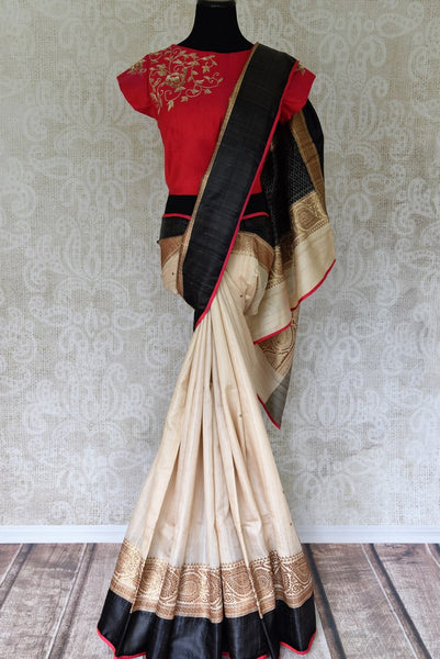Buy gorgeous cream saree online in USA with red embroidered sari blouse. Let your ethnic look shine with beautiful Indian designer sarees, handloom sarees, wedding sarees from Pure Elegance Indian fashion store in USA. You can also browse through our website and shop online.-full view