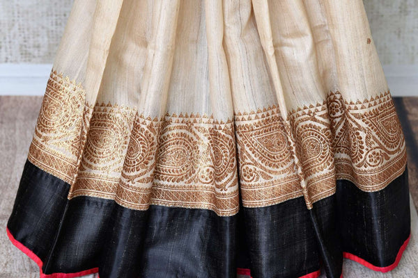 Buy gorgeous cream saree online in USA with red embroidered sari blouse. Let your ethnic look shine with beautiful Indian designer sarees, handloom sarees, wedding sarees from Pure Elegance Indian fashion store in USA. You can also browse through our website and shop online.-pleats