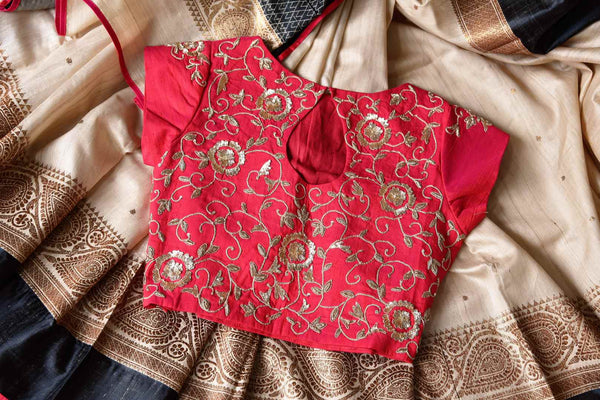 Buy gorgeous cream saree online in USA with red embroidered sari blouse. Let your ethnic look shine with beautiful Indian designer sarees, handloom sarees, wedding sarees from Pure Elegance Indian fashion store in USA. You can also browse through our website and shop online.-details