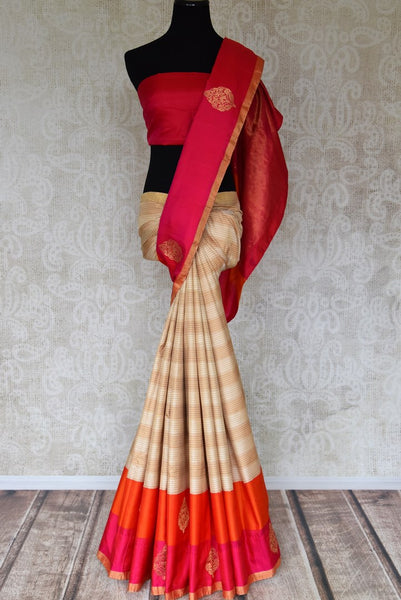 Buy stunning cream and beige striped Kanjeevaram saree online in USA with red embroidered sari blouse. Let your ethnic look shine with beautiful Indian designer sarees, handloom sarees, wedding sarees from Pure Elegance Indian fashion store in USA. You can also browse through our website and shop online.-full view