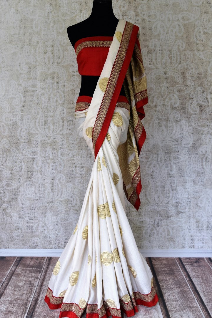 Buy white silk sari with embroidered border online in USA. Shop exclusive Indian designer saris, handloom sarees, Banarasi saris, wedding sarees in USA at Pure Elegance clothing store. Explore a range of traditional Indian women clothing also available at our online store. Shop now.-full view