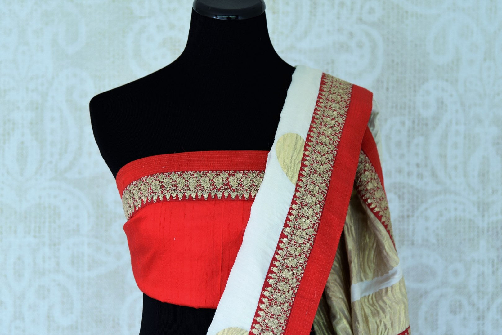 Buy white silk sari with embroidered border online in USA. Shop exclusive Indian designer saris, handloom sarees, Banarasi saris, wedding sarees in USA at Pure Elegance clothing store. Explore a range of traditional Indian women clothing also available at our online store. Shop now.-blouse pallu