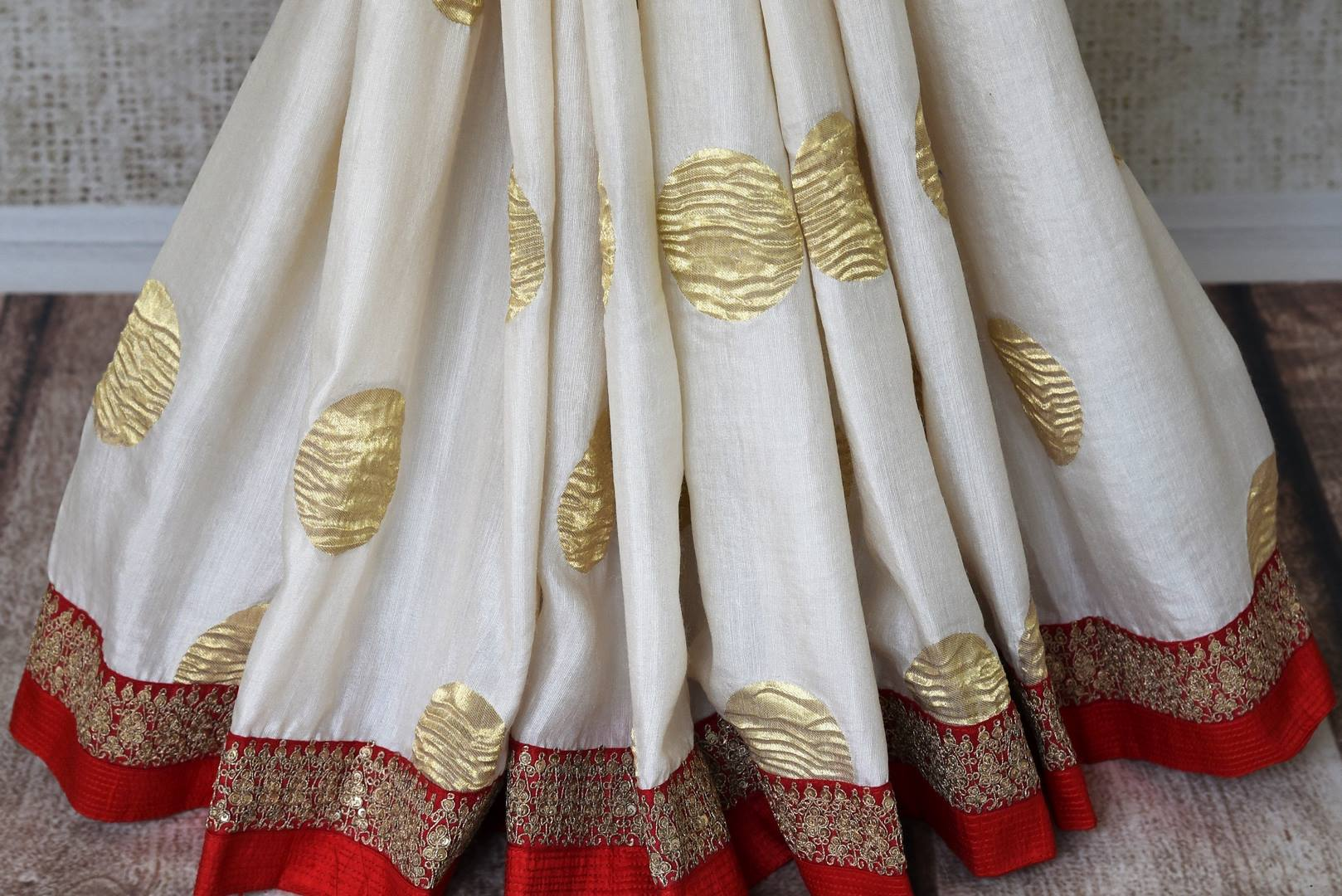 Buy white silk sari with embroidered border online in USA. Shop exclusive Indian designer saris, handloom sarees, Banarasi saris, wedding sarees in USA at Pure Elegance clothing store. Explore a range of traditional Indian women clothing also available at our online store. Shop now.-pleats