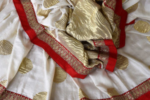 Buy white silk sari with embroidered border online in USA. Shop exclusive Indian designer saris, handloom sarees, Banarasi saris, wedding sarees in USA at Pure Elegance clothing store. Explore a range of traditional Indian women clothing also available at our online store. Shop now.-details