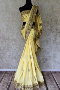 Buy cream color muga silk saree with hand embroidery online in USA. Shop exclusive Indian designer saris, handloom sarees, Banarasi saris, wedding sarees in USA at Pure Elegance clothing store. Explore a range of traditional Indian women clothing also available at our online store. Shop now.-full view