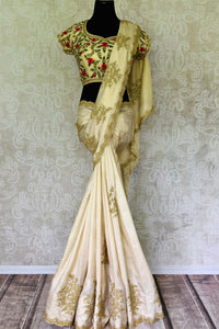 Buy off white embroidered crepe silk saree with sari blouse online in USA. Shop exclusive Indian designer saris, handloom sarees, Banarasi saris, wedding sarees in USA at Pure Elegance clothing store. Explore a range of traditional Indian women clothing also available at our online store. Shop now.-full view