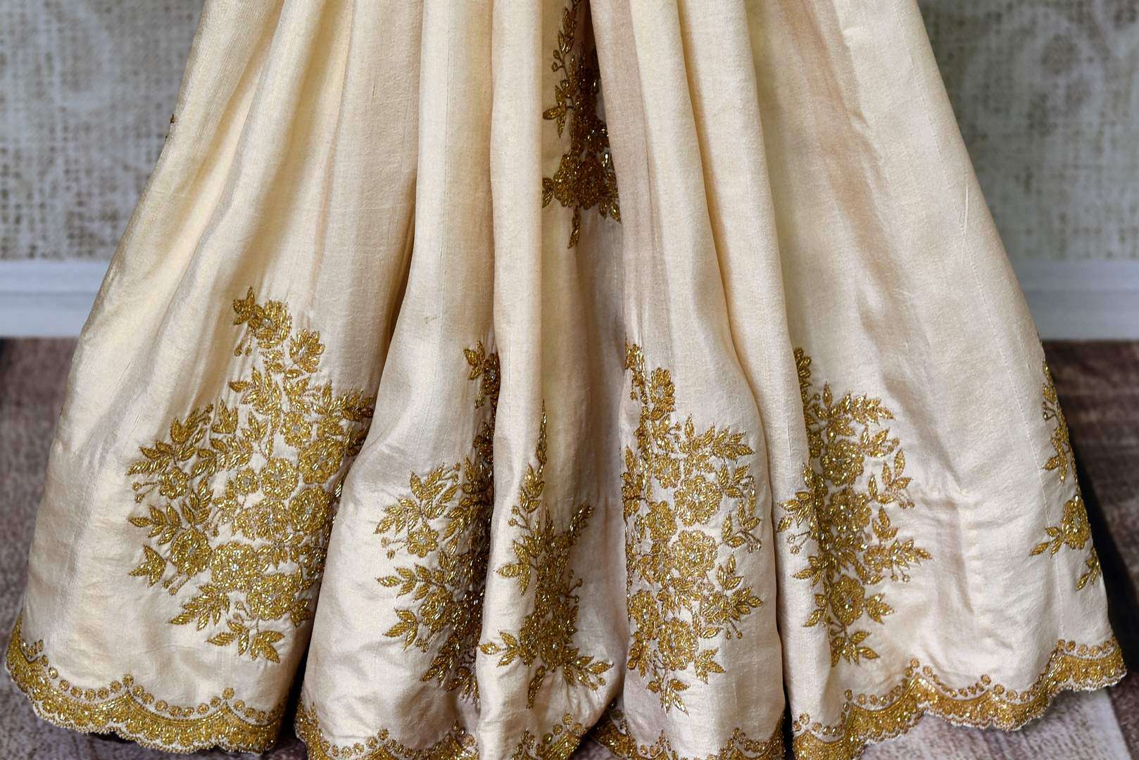Buy off white embroidered crepe silk saree with sari blouse online in USA. Shop exclusive Indian designer saris, handloom sarees, Banarasi saris, wedding sarees in USA at Pure Elegance clothing store. Explore a range of traditional Indian women clothing also available at our online store. Shop now.-pleats