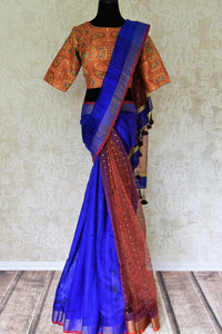 Buy blue and orange matka silk saree online in USA with readymade sari blouse. Let your ethnic look shine with beautiful Indian designer sarees, handloom sarees, wedding saris from Pure Elegance Indian fashion store in USA. You can also browse through our website and shop online.-full view
