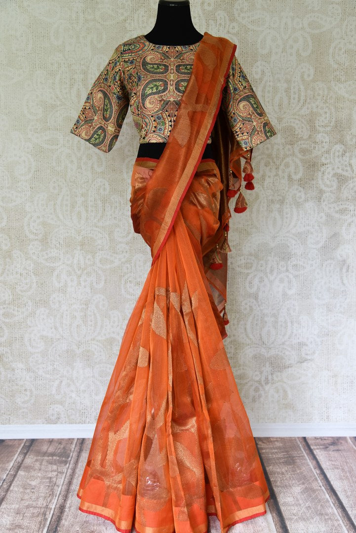 Buy orange matka silk saree online in USA with printed sari blouse. Make every occasion special with beautiful Indian designer sarees, handloom sarees, wedding saris from Pure Elegance Indian fashion store in USA. You can also browse through our website and shop online.-full view