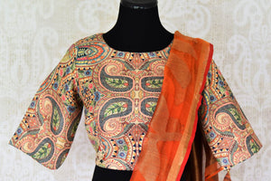 Buy orange matka silk saree online in USA with printed sari blouse. Make every occasion special with beautiful Indian designer sarees, handloom sarees, wedding saris from Pure Elegance Indian fashion store in USA. You can also browse through our website and shop online.-blouse pallu