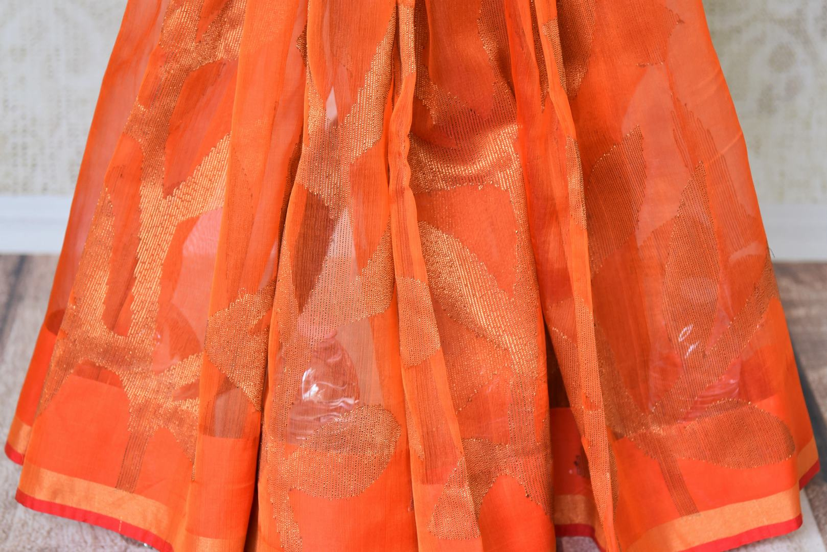 Buy orange matka silk saree online in USA with printed sari blouse. Make every occasion special with beautiful Indian designer sarees, handloom sarees, wedding saris from Pure Elegance Indian fashion store in USA. You can also browse through our website and shop online.-pleats