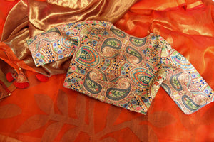 Buy orange matka silk saree online in USA with printed sari blouse. Make every occasion special with beautiful Indian designer sarees, handloom sarees, wedding saris from Pure Elegance Indian fashion store in USA. You can also browse through our website and shop online.-details