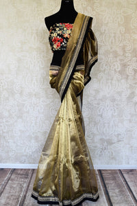 Shop stunning gold tissue saree with embroidered border online in USA from Pure Elegance. Let your ethnic style be one of a kind with an exquisite variety of Indian designer sarees, pure silk sarees, Bollywood sarees from our exclusive fashion store in USA.-full view