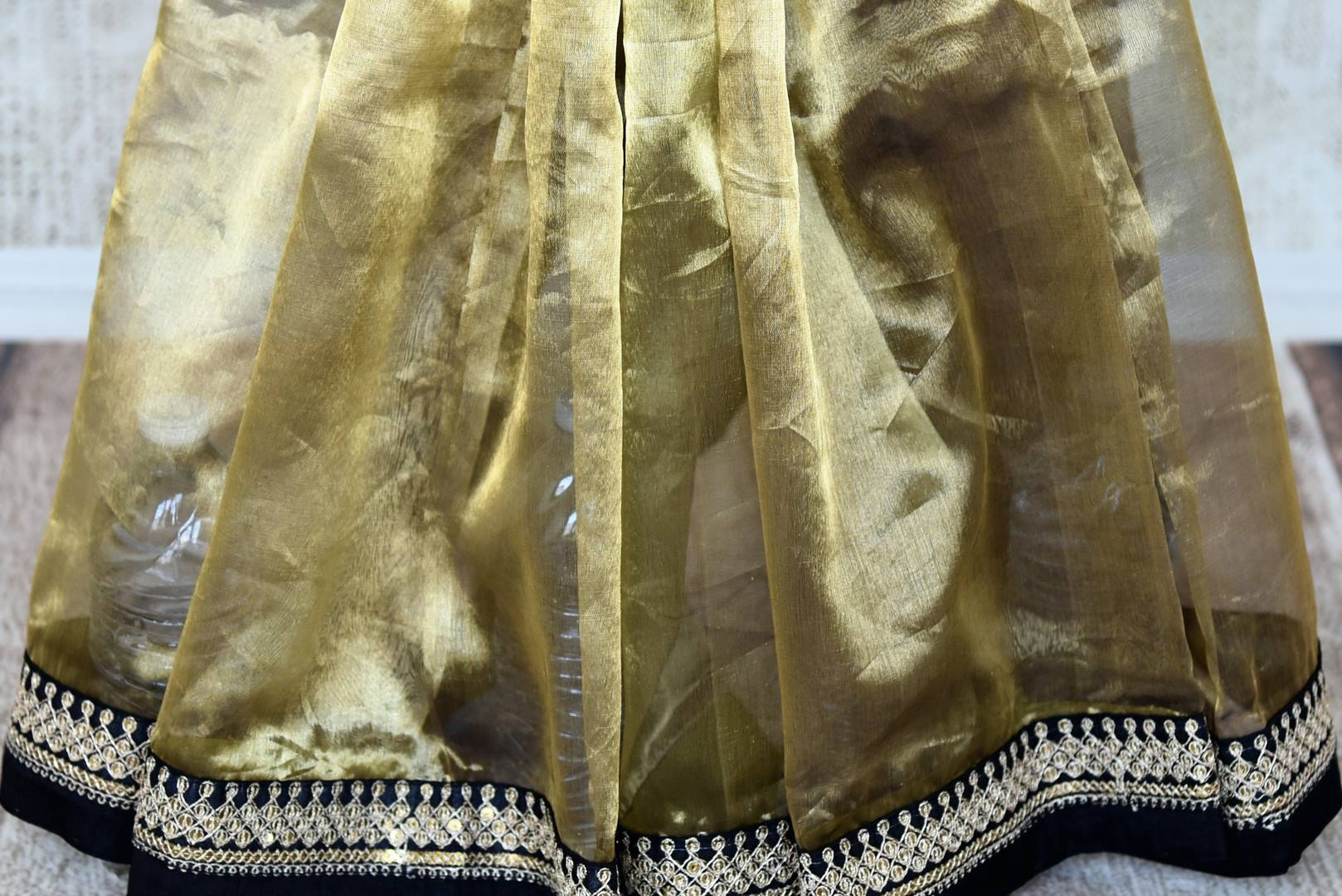 Shop stunning gold tissue saree with embroidered border online in USA from Pure Elegance. Let your ethnic style be one of a kind with an exquisite variety of Indian designer sarees, pure silk sarees, Bollywood sarees from our exclusive fashion store in USA.-pleats