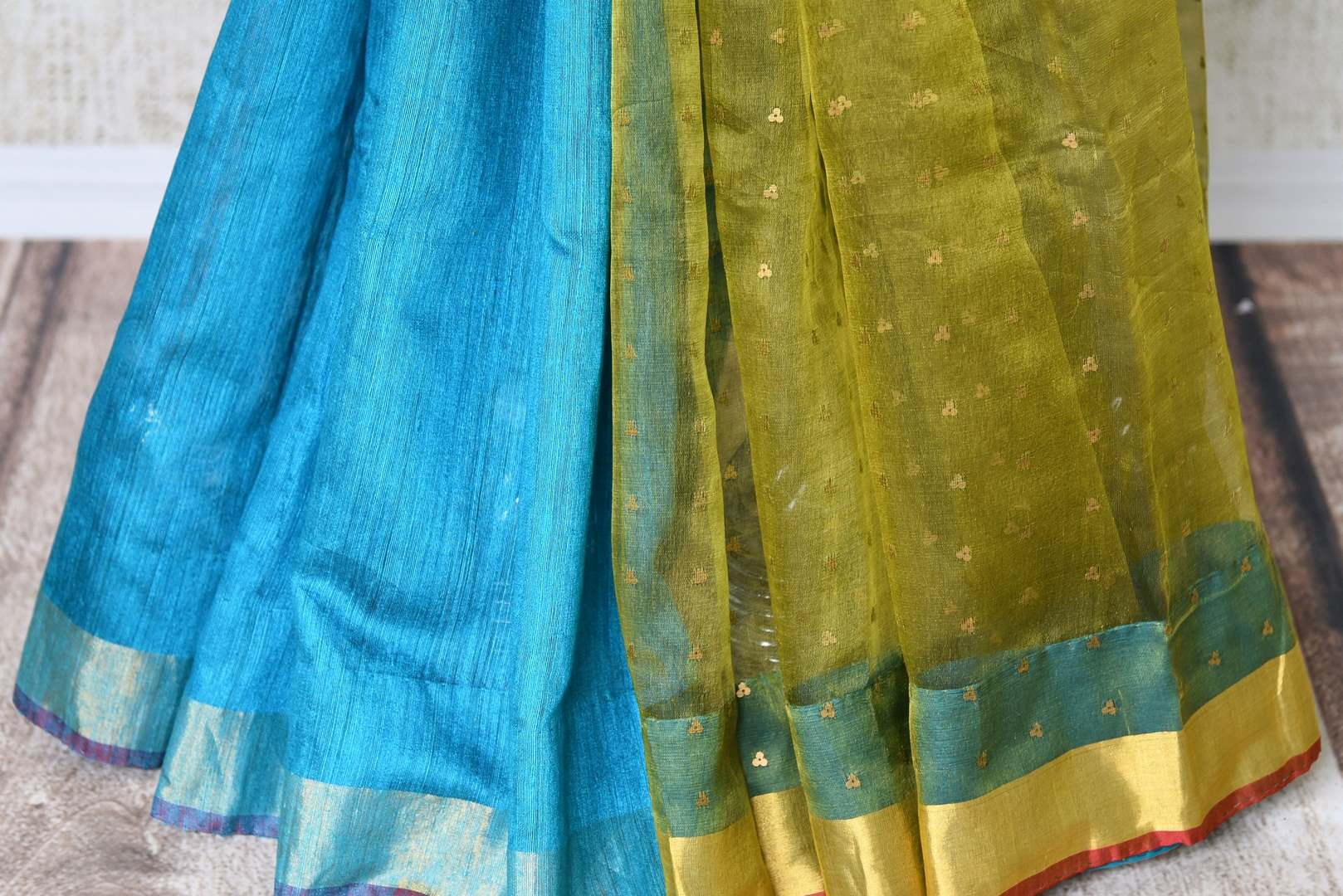 Buy blue and green woven matka silk saree online in USA with printed sari blouse. Make every occasion special with beautiful Indian designer sarees, handloom sarees, wedding saris from Pure Elegance Indian fashion store in USA. You can also browse through our website and shop online.-pleats