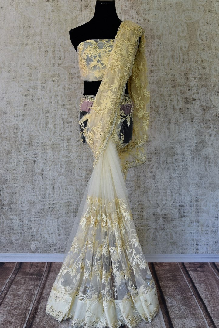 Buy off-white embroidered net saree online in USA. Adorn your style with a range of exquisite sarees with blouses from Pure Elegance Indian clothing store in USA. We have an exquisite range of Indian designer sarees, silk sarees, Banarasi saris and many other varieties also available at our online store.-full view