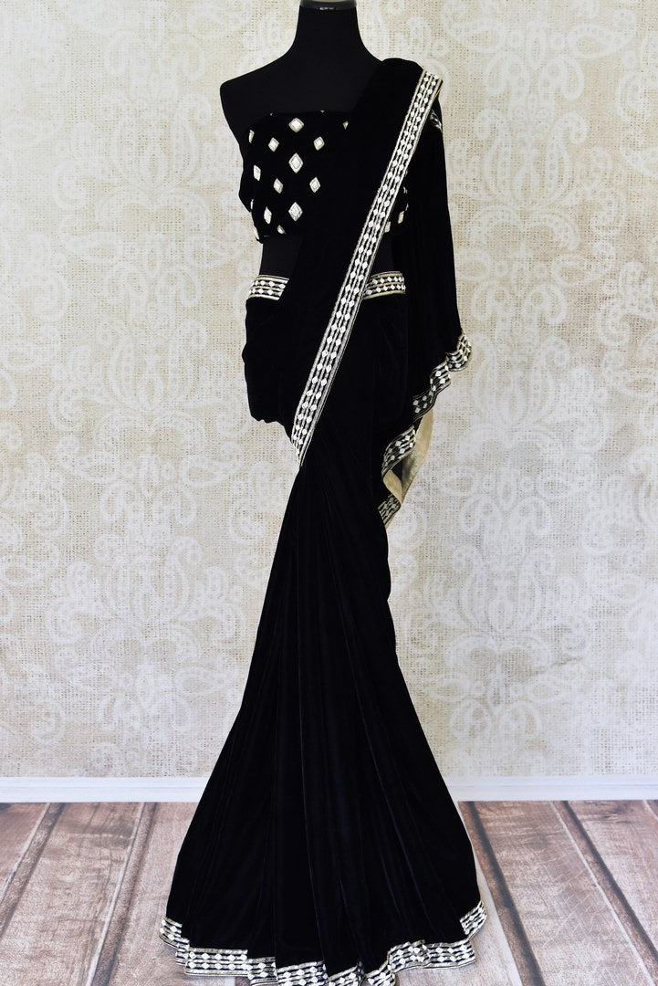 Buy black embroidered velvet saree online in USA. Find an exquisite range of Bollywood sarees with blouses in USA at Pure Elegance Indian clothing store. Enhance your ethnic look with a variety of silk saris, Kanchipuram sarees, and Indian jewelry available at our online store.-full view