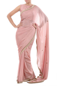 Buy light pink kundan embellished crepe saree with blouse online in USA. Pure Elegance Indian fashion store presents an alluring collection of Indian designer sarees, wedding sarees in USA for parties, weddings and special occasions.-full view