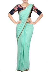 Buy pista green sari with royal blue embroidered saree blouse online in USA. Pure Elegance Indian fashion store presents an alluring collection of Indian designer sarees, wedding saris, designer saree blouses in USA for parties, weddings and special occasions.-full view