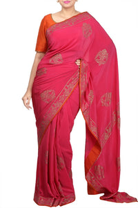 Shop elegant pink crepe saree online in USA with gold block print. For Indian women in USA, Pure Elegance Indian clothing store brings an exquisite range of Indian designer sarees, bridal saris, handloom saris for parties, weddings and special occasions. -full view