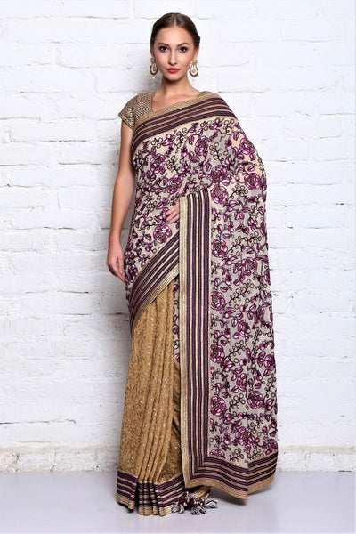 Buy beige & purple hand embroidered georgette sari online in USA with stitched blouse. Stand amongst the crowd with an exclusive range of Indian designer sarees, wedding saris, handloom sarees from Pure Elegance Indian fashion store in USA. -full view