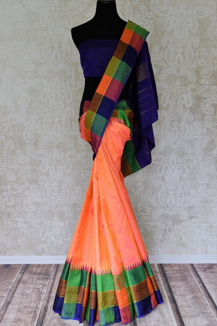 Shop orange color Kanjeevaram silk sari online in USA with check border. Find a range of Indian Kanchipuram sarees at Pure Elegance clothing store in USA. Elevate your traditional style with a range of Indian clothing, designer silk sarees, wedding sarees, and much more also available at our online store. -full view