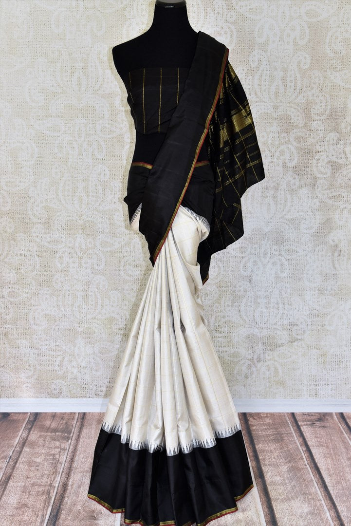 Buy off white Kanjivaram silk saree with black border online in USA. Find a range of Indian Kanchipuram saris at Pure Elegance clothing store in USA. Elevate your traditional style with a range of Indian clothing, designer silk sarees, wedding sarees, and much more also available at our online store.-full view