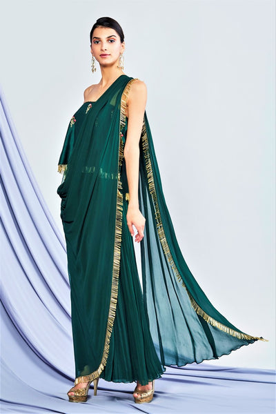 Buy designer bottle green off shoulder jumpsuit saree online in USA. Shop exclusive Indian designer saris, party sarees, wedding sarees in USA at Pure Elegance clothing store. Explore a range of traditional Indian women clothing also available at our online store. Shop now.-full view