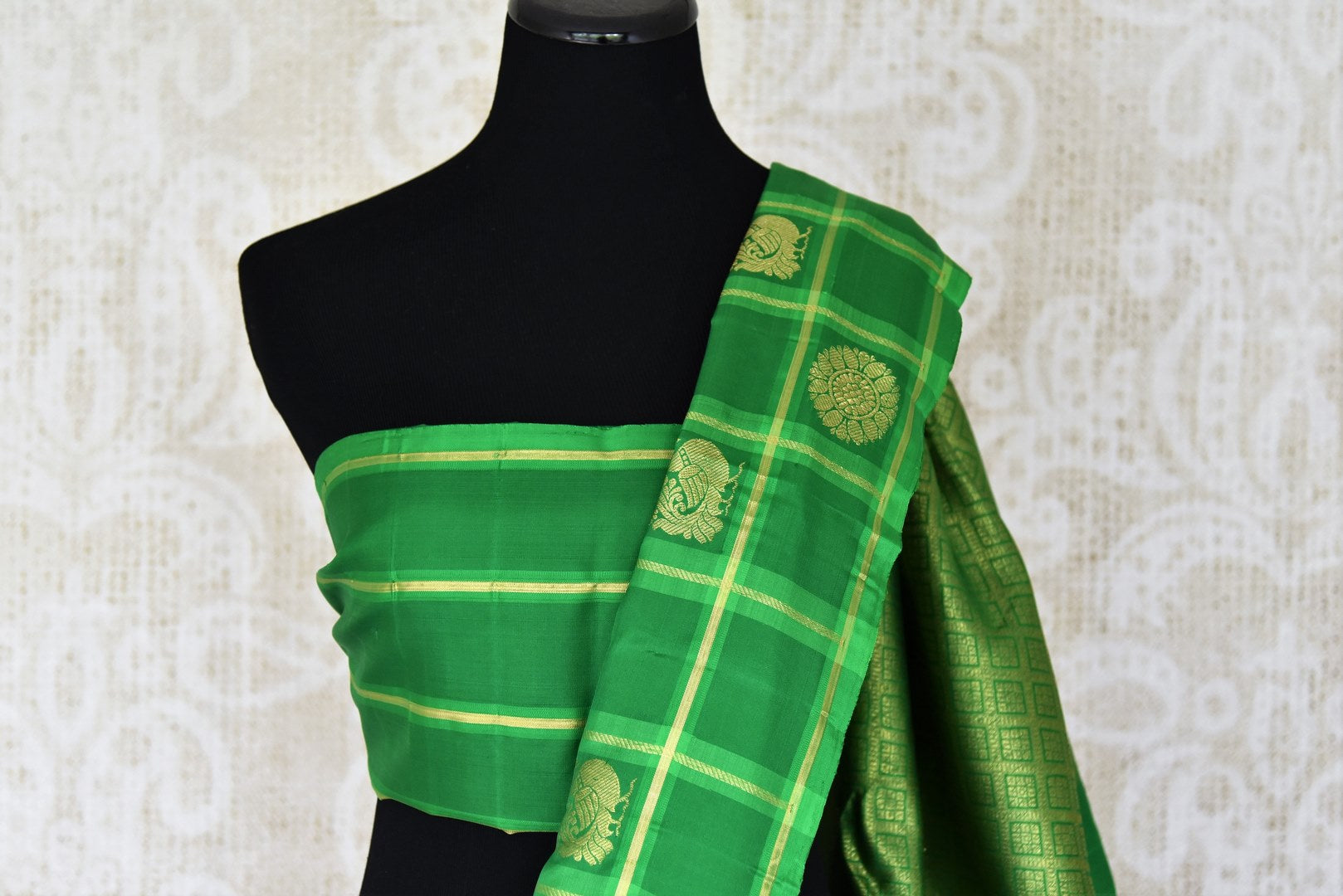 Buy brown Kanjivaram silk saree online in USA with green check border and zari buta. For more such gorgeous designer saris, shop at Pure Elegance Indian fashion store in USA. A beautiful range of traditional Kanchipuram silk saris is available for Indian women living in USA. You can also shop at our online store.-blouse pallu