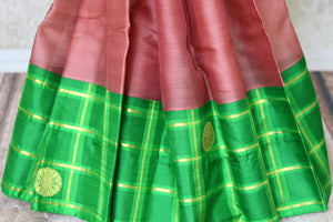 Buy brown Kanjivaram silk saree online in USA with green check border and zari buta. For more such gorgeous designer saris, shop at Pure Elegance Indian fashion store in USA. A beautiful range of traditional Kanchipuram silk saris is available for Indian women living in USA. You can also shop at our online store.-pleats