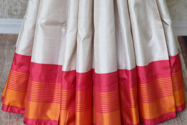 Buy white Kanjeevaram silk sari with elephant zari buta online in USA. Find an exquisite range of Kanchipuram saris in USA at Pure Elegance Indian clothing store. Enhance your ethnic look with a variety of designer silk sarees available at our online store.-pleats