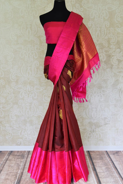 Buy maroon Kanjivaram silk saree with pink border and zari buta online in USA. Find a range of Indian Kanchipuram silk saris at Pure Elegance clothing store in USA. Elevate your traditional style with a range of Indian clothing, designer silk sarees, wedding sarees, and much more also available at our online store.-full view