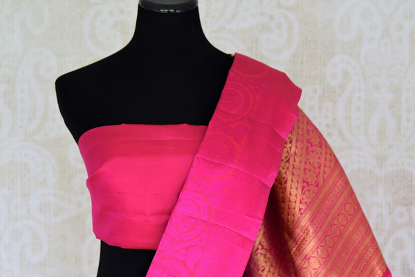 Buy maroon Kanjivaram silk saree with pink border and zari buta online in USA. Find a range of Indian Kanchipuram silk saris at Pure Elegance clothing store in USA. Elevate your traditional style with a range of Indian clothing, designer silk sarees, wedding sarees, and much more also available at our online store.-blouse pallu
