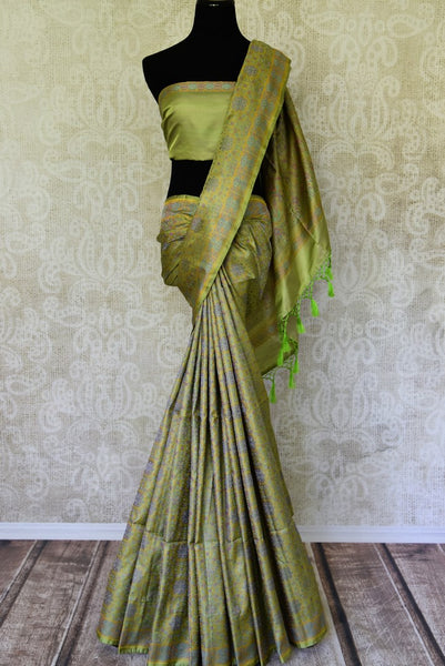 Buy green printed Tanchoi Banarasi silk sari online in USA. For more such gorgeous designer silk saris, shop at Pure Elegance Indian clothing store in USA. A beautiful range of traditional Banarasi sarees, silk saris is available for Indian women living in USA. You can also shop at our online store.-full view