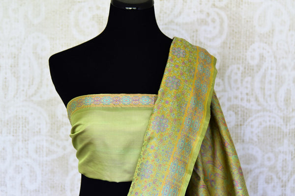 Buy green printed Tanchoi Banarasi silk sari online in USA. For more such gorgeous designer silk saris, shop at Pure Elegance Indian clothing store in USA. A beautiful range of traditional Banarasi sarees, silk saris is available for Indian women living in USA. You can also shop at our online store.-blouse pallu