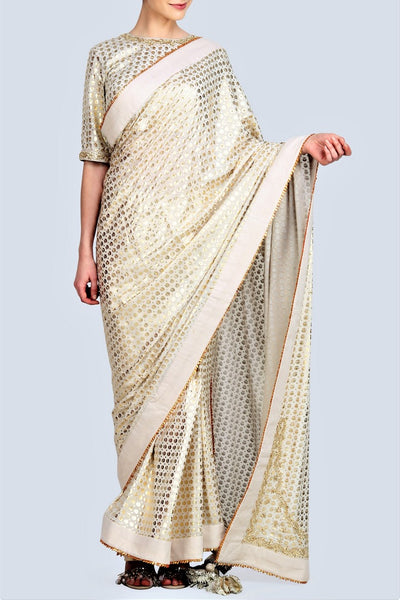 Shop captivating white color embroidered crepe saree with blouse online in USA. The saree is adorned with gold foil print. For more such gorgeous designer sarees, shop at Pure Elegance Indian fashion store in USA. A beautiful range of exclusive Indian sarees and clothing is available for Indian women living in USA...-full view