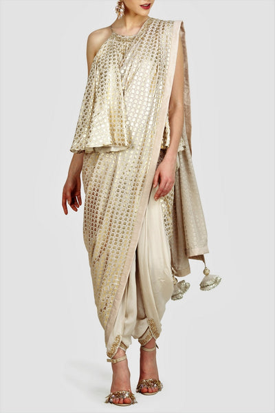 Buy off-white sangha gold foil print dhoti saree online in USA with halter neck top. For more such gorgeous designer sarees with blouses, shop at Pure Elegance Indian fashion store in USA. A beautiful range of traditional Indian sarees and clothing is available for Indian women living in USA. You can also shop at our online store.-full view
