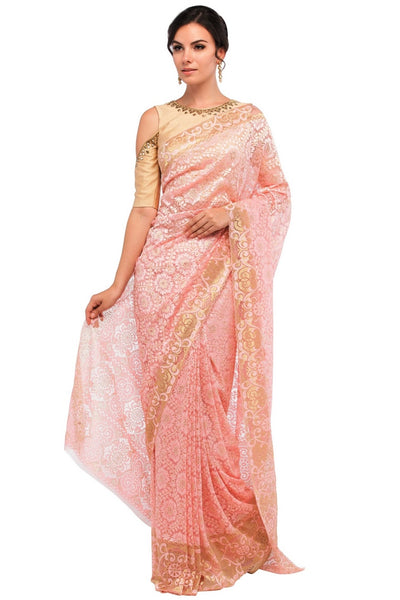 Buy peach color floral pattern lace saree with blouse piece online in USA at Pure Elegance online store. Give yourself a brilliant makeover with a range of exquisite Indian designer sarees from our clothing store in USA. Choose as per your taste whether it is wedding sarees, traditional silk sarees, handloom sarees we have got all under one roof. -full view