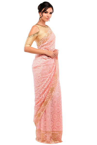 Buy peach color floral pattern lace saree with blouse piece online in USA at Pure Elegance online store. Give yourself a brilliant makeover with a range of exquisite Indian designer sarees from our clothing store in USA. Choose as per your taste whether it is wedding sarees, traditional silk sarees, handloom sarees we have got all under one roof. -side view