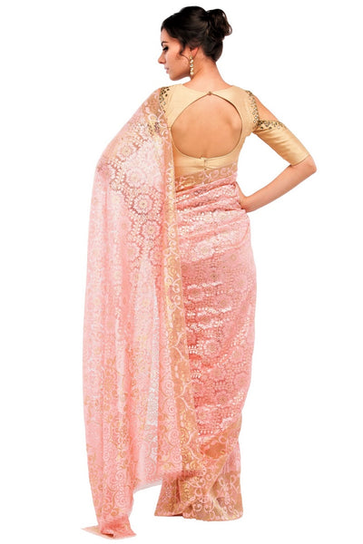 Buy peach color floral pattern lace saree with blouse piece online in USA at Pure Elegance online store. Give yourself a brilliant makeover with a range of exquisite Indian designer sarees from our clothing store in USA. Choose as per your taste whether it is wedding sarees, traditional silk sarees, handloom sarees we have got all under one roof. -back